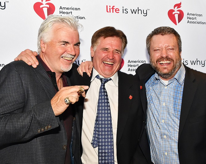 Three men laughing at event