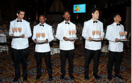 Waiters holding trays of champaign