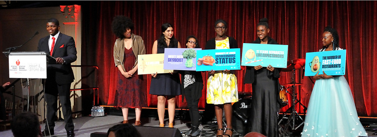 Students holding nutrition signs